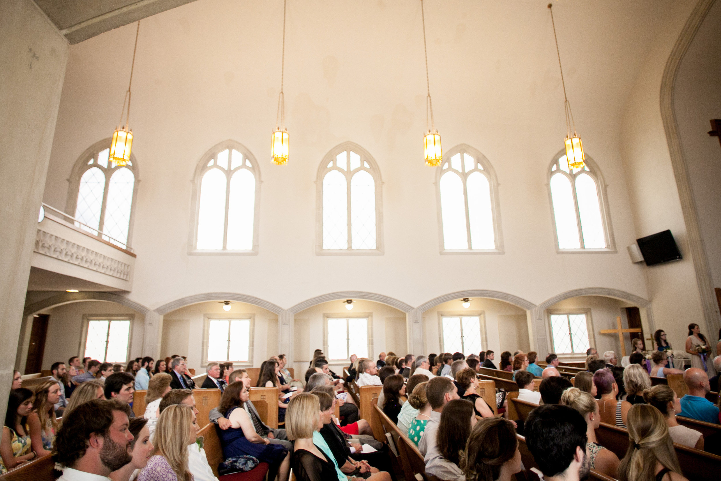 A sweet, personalized wedding ceremony at the lovely  Strong Tower Fellowship Church.