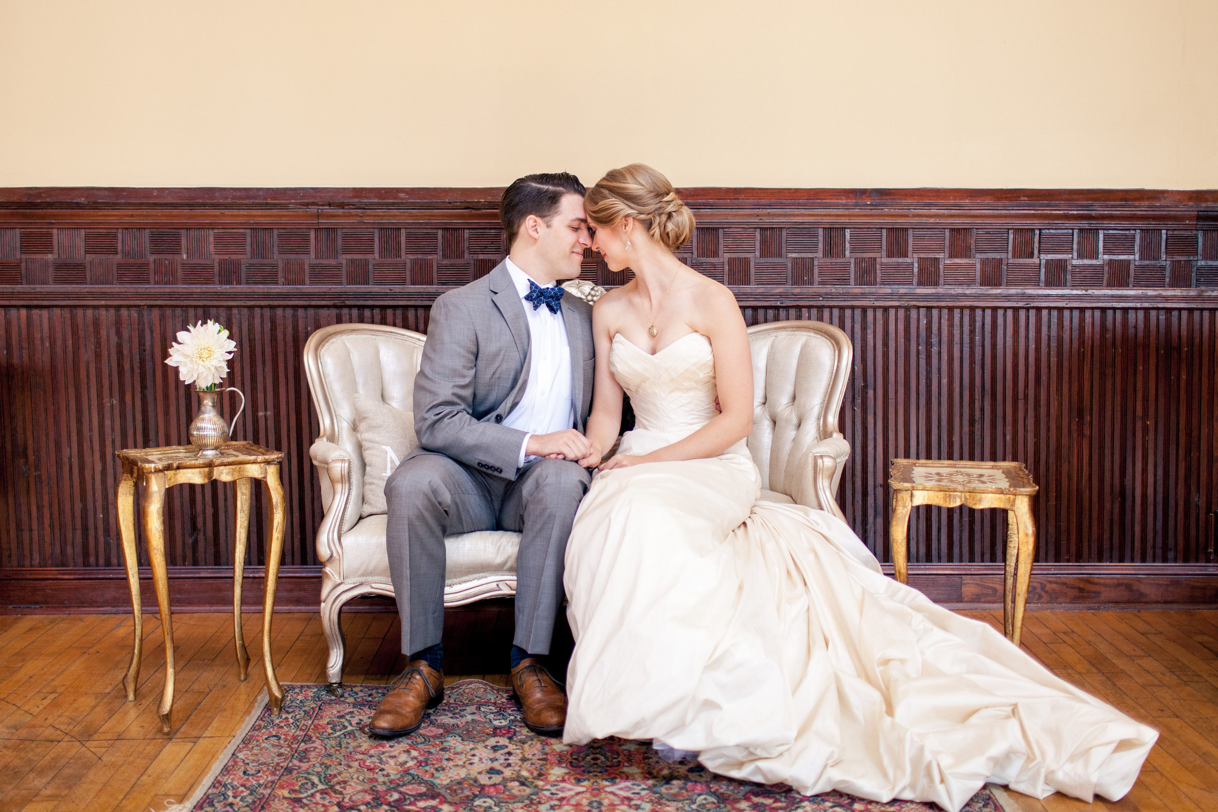 Instead of a sweetheart table, the bride and groom had their own a sweetheart lounge area situated right next to the dance floor. A sweet spot for them to rest, snuggle, sip, and people-watch.Their nook used our  Lady Sybil love seat, Luciano side tables (gold florentine), Jess  area rug, and some accent pillows.
