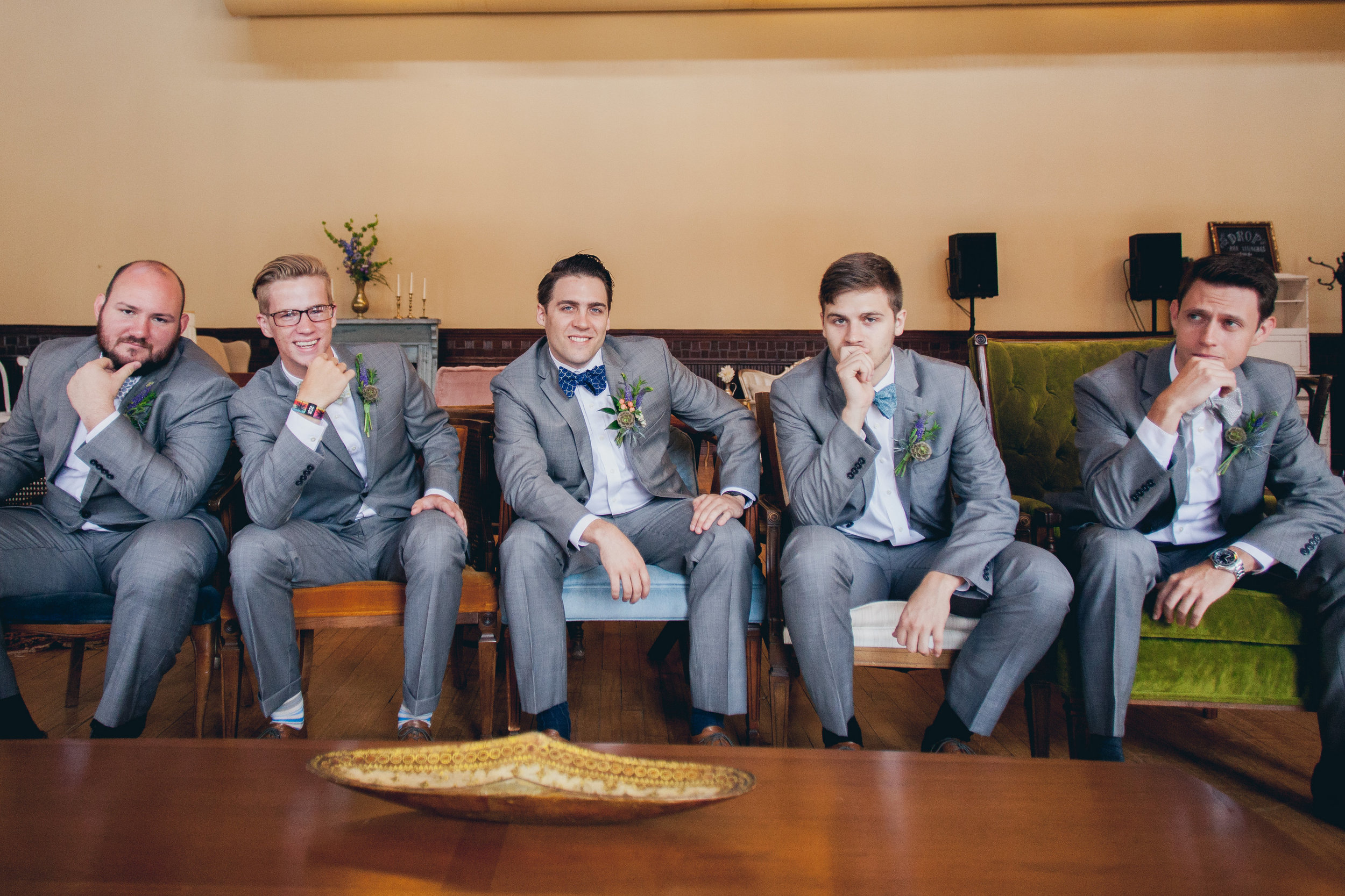 Handsome groom and groomsmen in our mod chair collection.