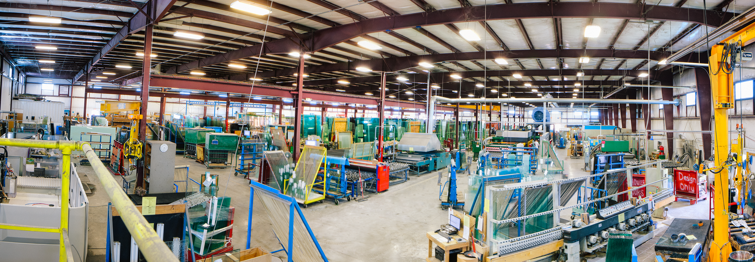 Production floor of Custom Glass Products in Weston, Wisconsin. Built by Wanta & Son, Inc.