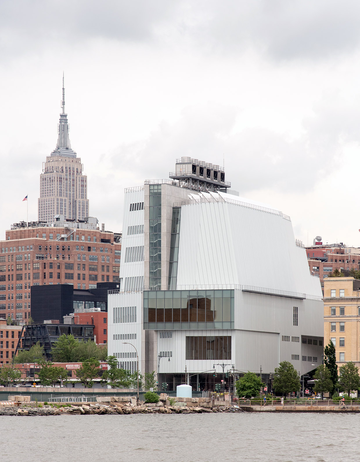 The new Whitney Museum and the Empire State Building from the Hudson River, NYC.