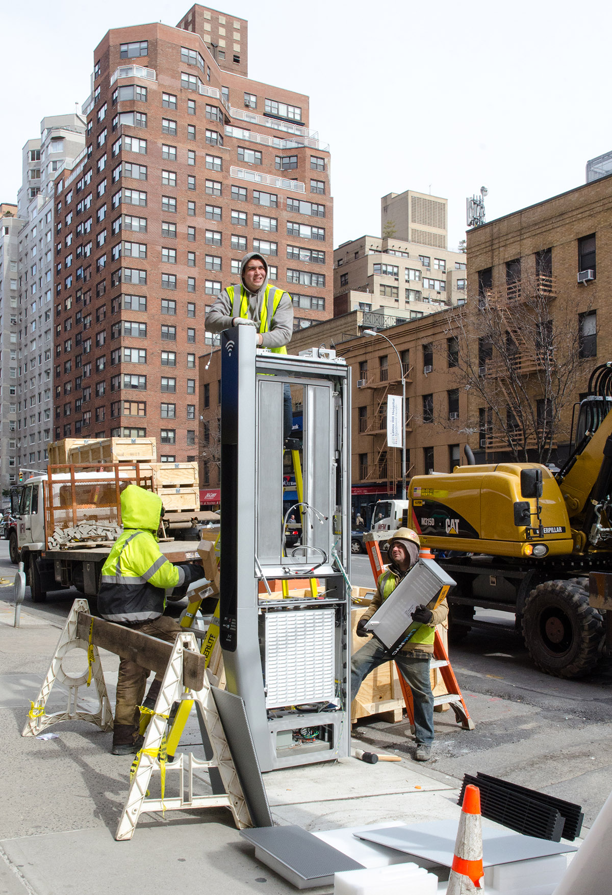 Phone booth of the 21st century. LinkNYC going in on the Upper East Side, NYC.