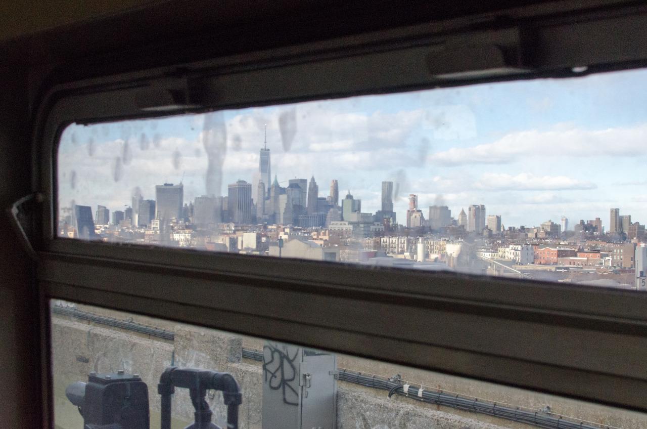 Manhattan from the G Train. Brooklyn, NY.