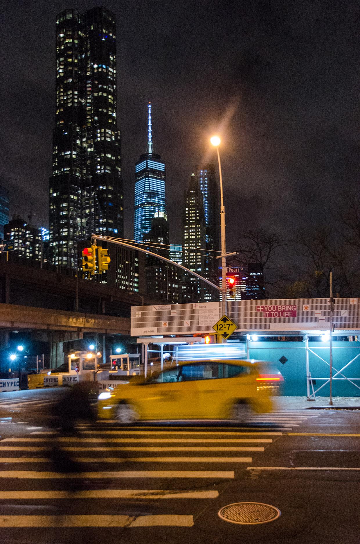 Walking Two Bridges at night. Manhattan, NYC.