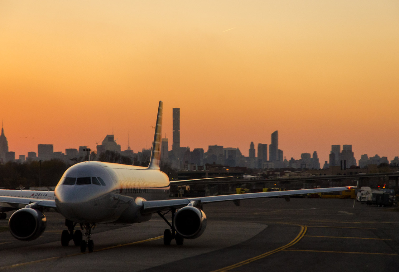 Waiting on the runway at LaGuardia as the sun goes down, Queens, NYC.