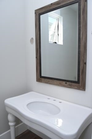 Pedestal sink in powder room