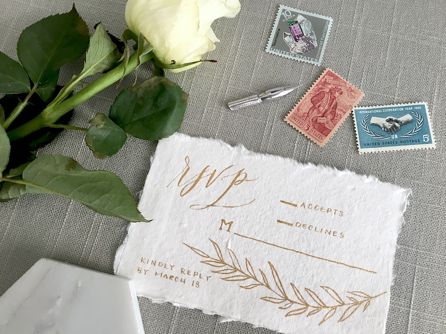 """This RSVP card shows the traditional approach of adding an """"M"""" with a line next to it for the guests to fill in their names when they reply! I calligraphed this RSVP card on  Fabulous Fancy Pants  paper with gold ink from  Fox & Quills  for a styled shoot."""