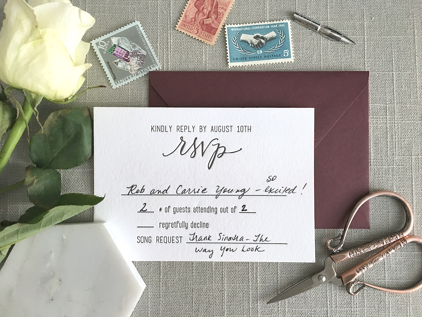 """This is a returned RSVP card for my wedding! As you can see, I didn't include the capital """"M"""" for Mr. or Mrs. The photo also shows where I wrote in the number of guests that were included in the invitation (this was most helpful for large families with lots of younger kids)."""