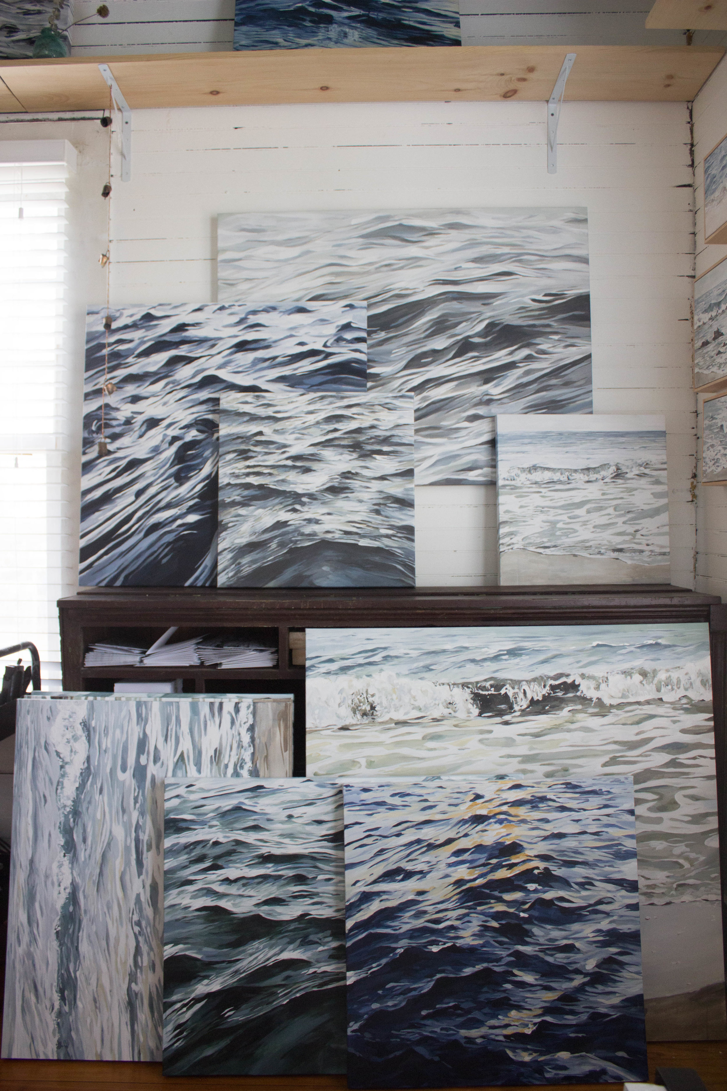 A grouping of paintings completed by Brynn Casey and stored in her studio before a big art release!