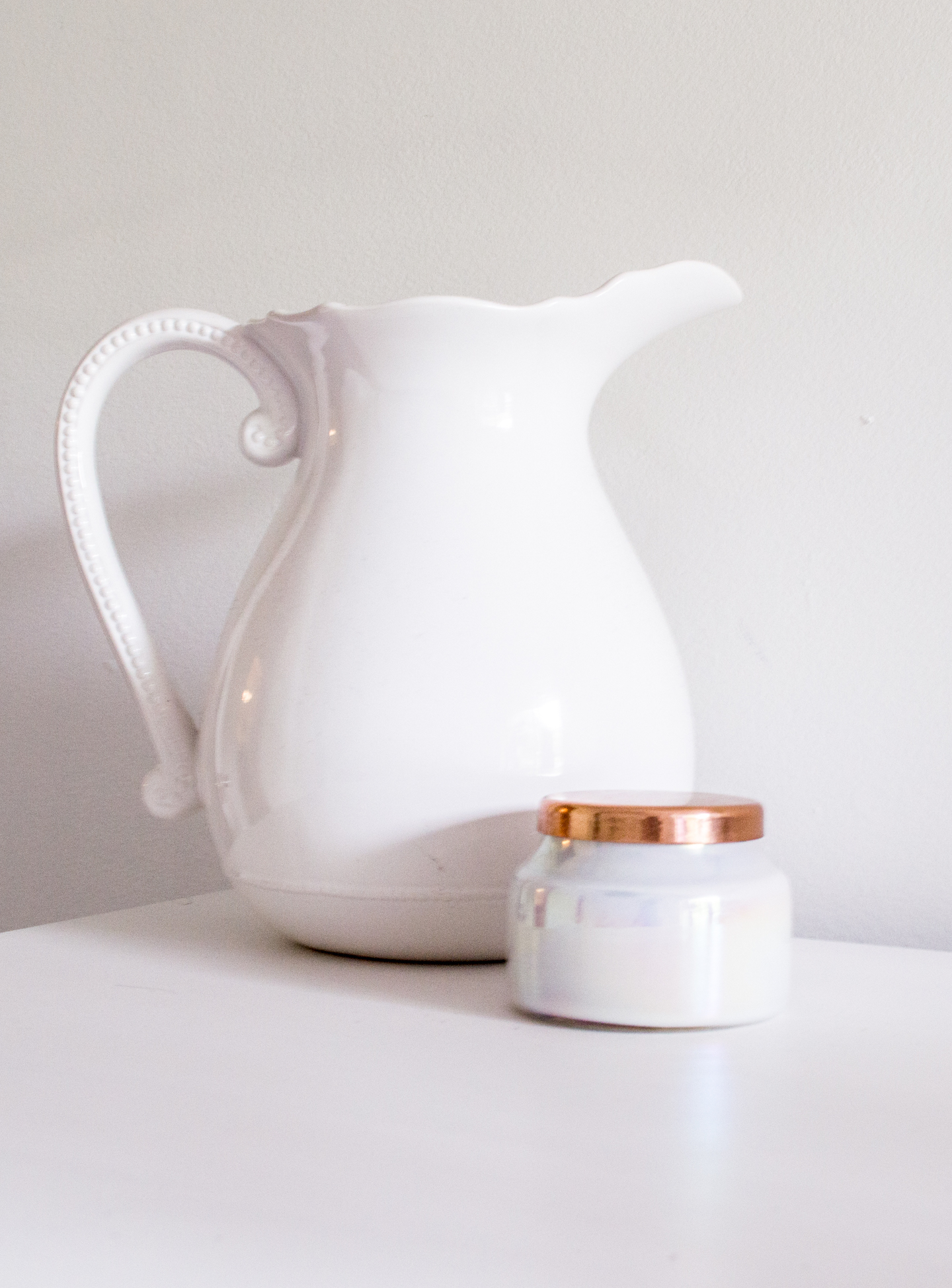 White Anthropologie Pitcher with Mini Volcano Candle