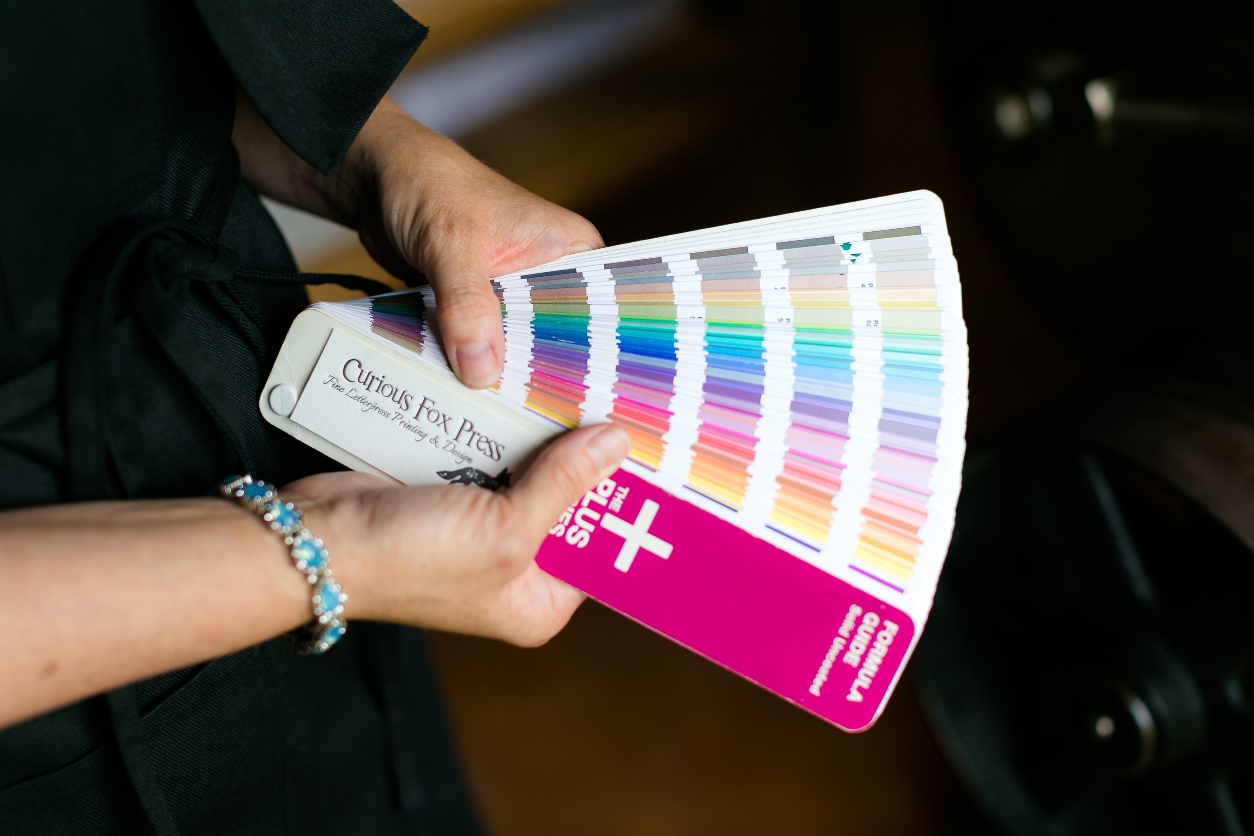 This Pantone color book is an example of the reference book that most letterpress printers will use! Each color swatch gives a formula for mixing the color correctly.  LOVE KNOT PHOTO.
