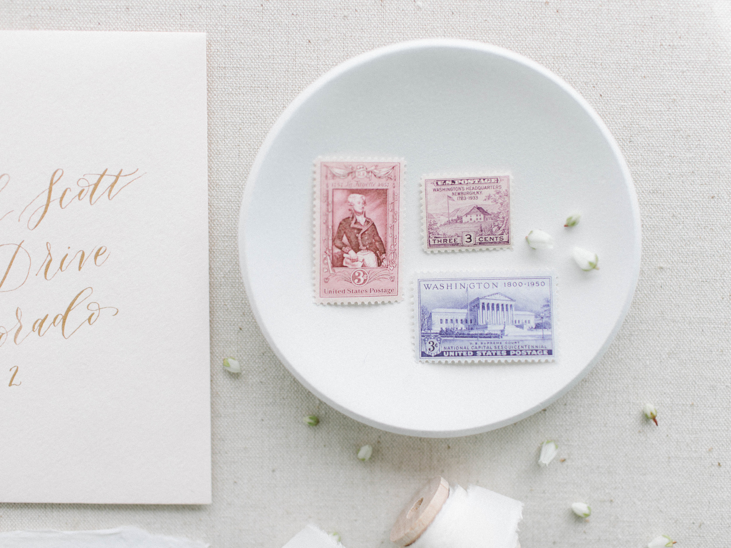 """Photo by Katherine Ridgely. An additional picture of some beautiful vintage postage that could be used on wedding invitations if you want! The great thing about USPS stamps is that they never expire until they are """"cancelled"""" and they always keep their face value."""