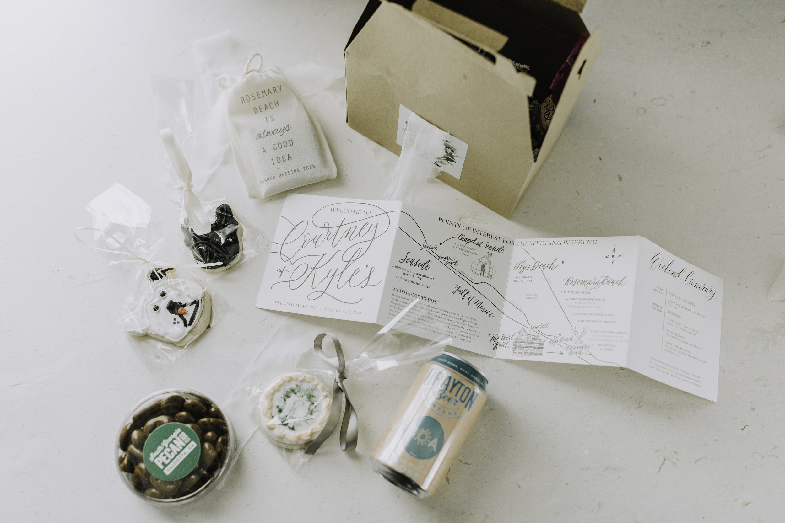 photo by lauren bailey photography. This showcases a gorgeous welcome weekend map & itinerary we made for our client's guests to enjoy in their welcome baskets. The map features 2 wedding venue illustrations - one for where the ceremony was held, and the other for where the reception was held!
