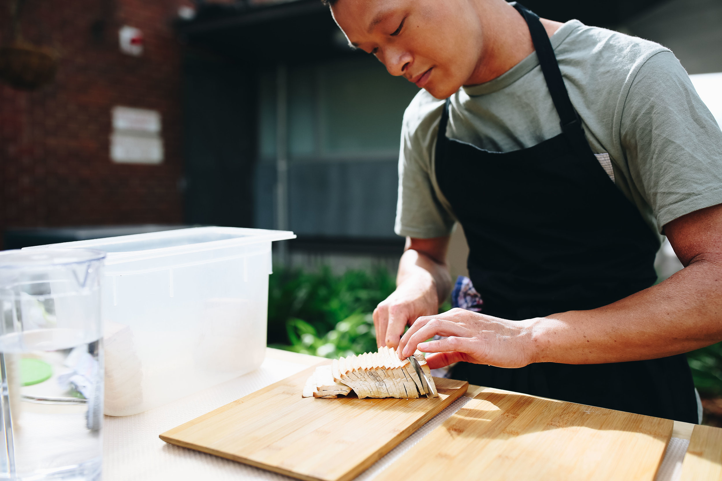 Julian preparing some smoked tofu to be incorporated into his rice paper rolls later.