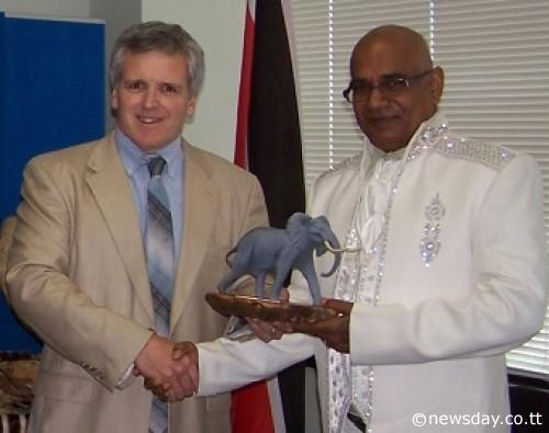 AWARD:  US  wildlife biologist DJ Schubert, left, presents the 2013 Clark R Bavin Wildlife Law Enforcement Award to retired  Trinidad and Tobago  game warden Samsundar Ramdeen on August 2 in  New York  .