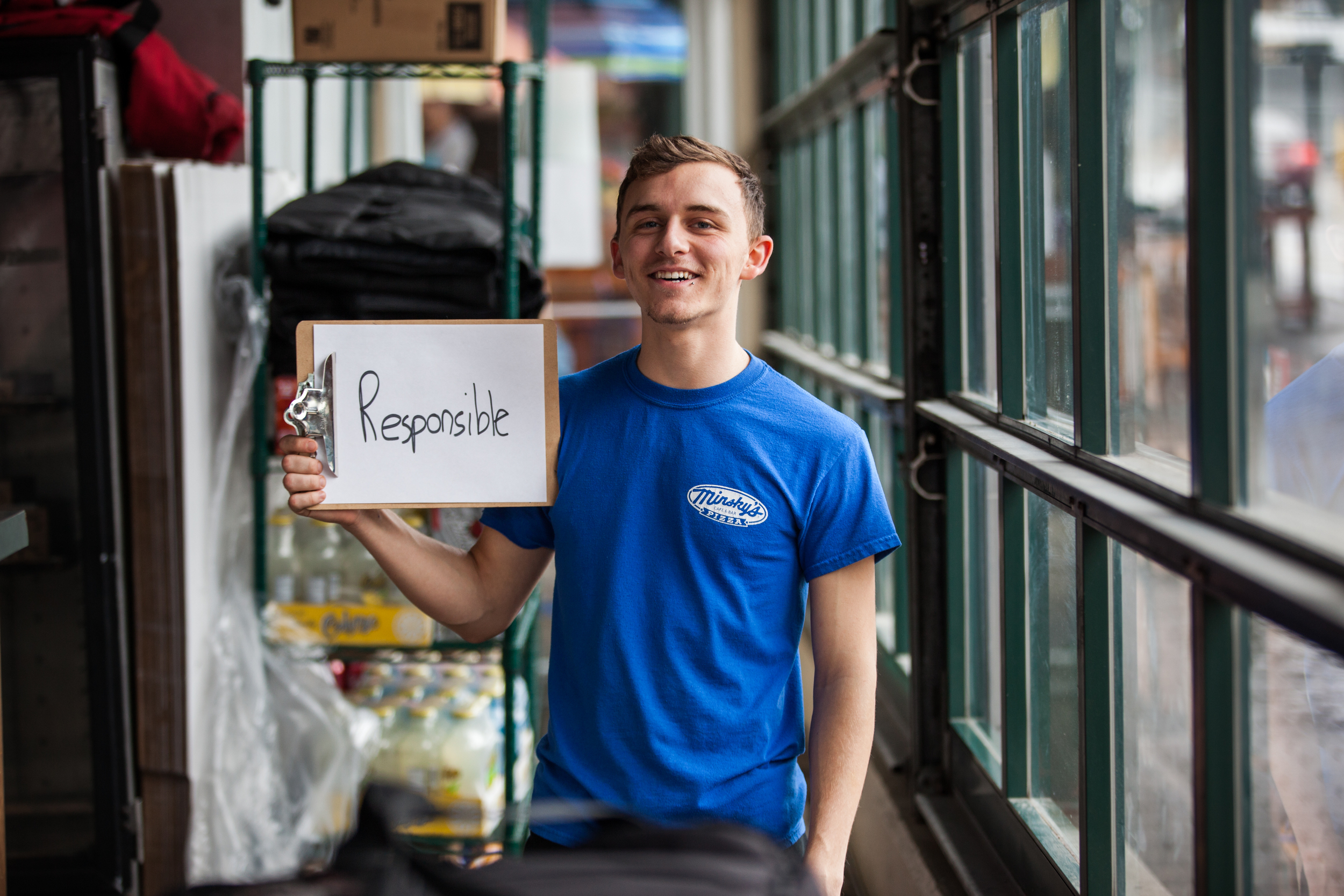 Young man holding a sign saying responsible.