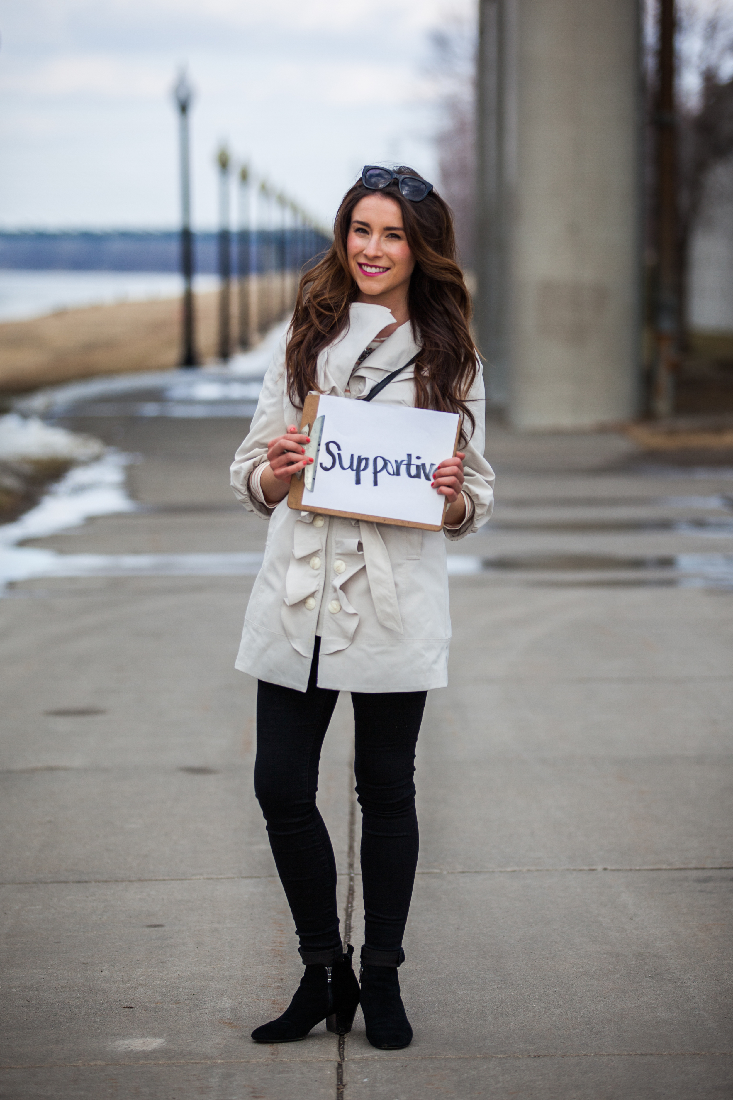 Woman holding a sign saying supportive.