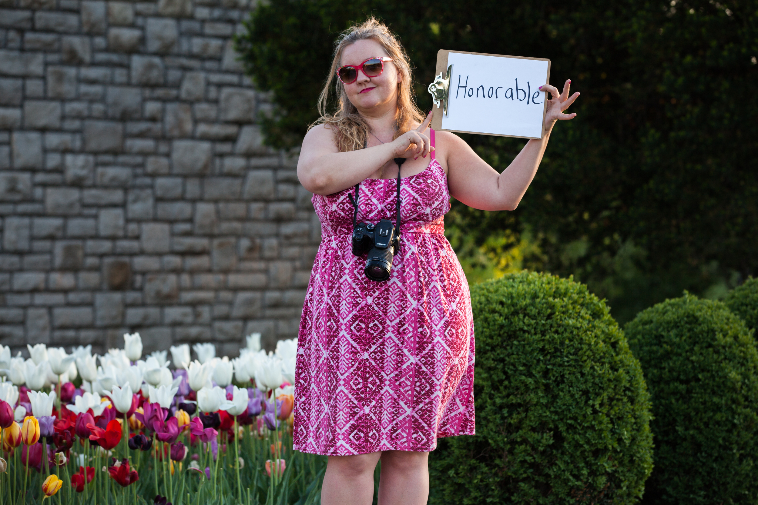 Woman holding a sign that says honorable.