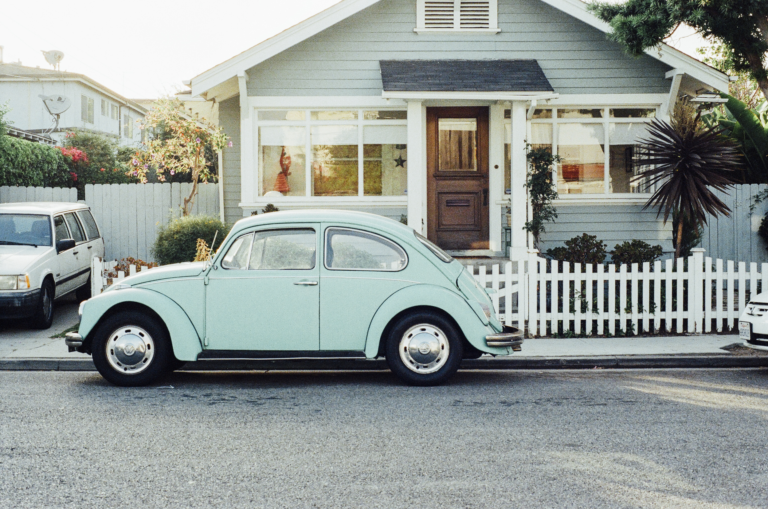 Beetle Car, House, White picket fence