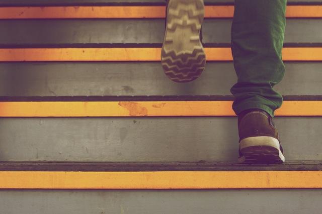Man walking up stairs.