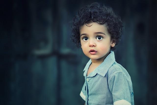 Small boy looking at camera.