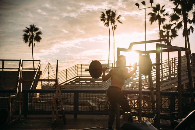 Man working out in outdoor gym.