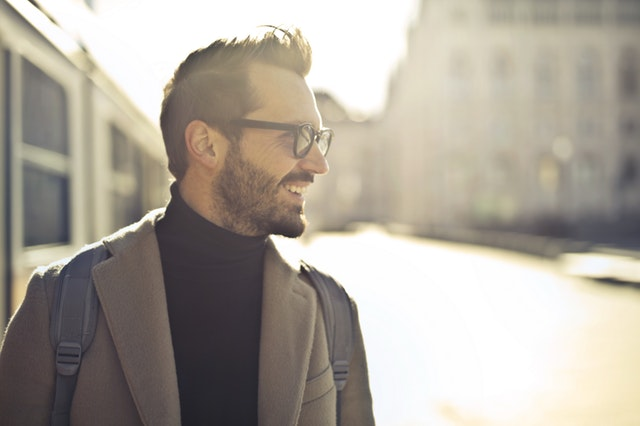 Confident man wearing glasses and a nice jacket.