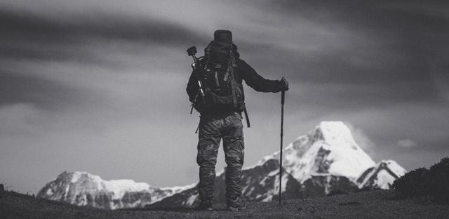 Confident man hiking through the mountains.