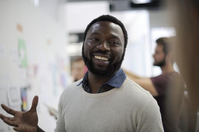 Confident man smiles at camera.