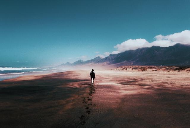 man walking on a beach thinking about masculinity