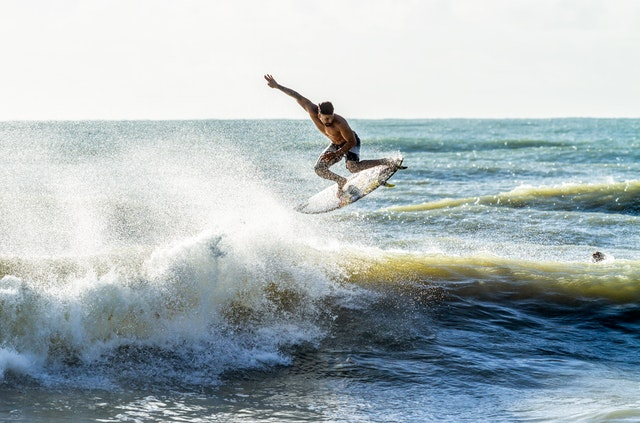 dude surfing and being masculine