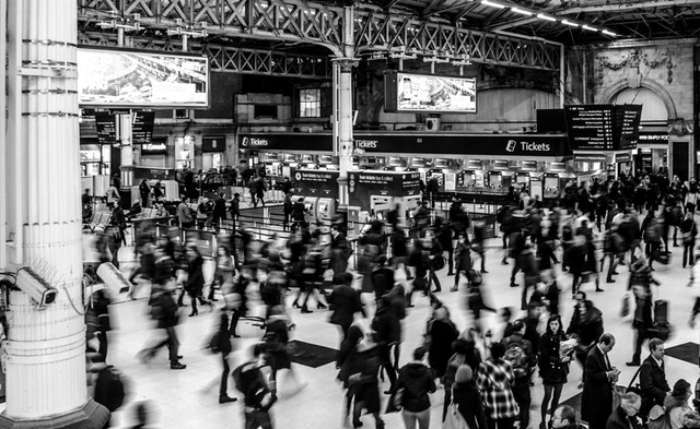 a crowd of people in a train station