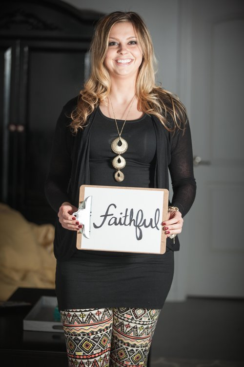 blonde girl standing and holding Faithful sign