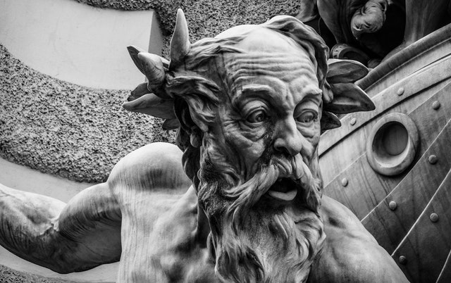 old sculpture and statue that is an old man with a beard