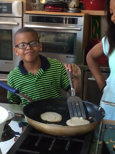 Kolby helping out with the pancakes!