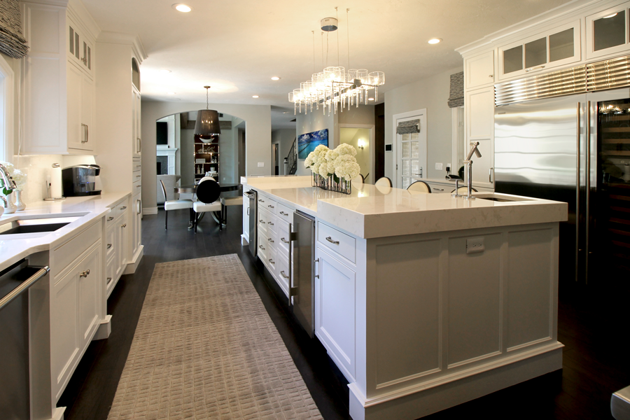 The living room flows into the kitchen area, which Buxton gave a clean, contemporary aesthetic. The space was completely gutted and updated with brand-new cabinets, appliances, flooring, lighting and other features.