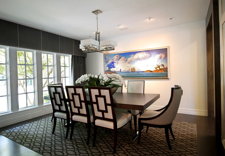 Buxton designed the formal dining room around one of the homeowners' favorite pieces of artwork, which serves as the focal point of the space.