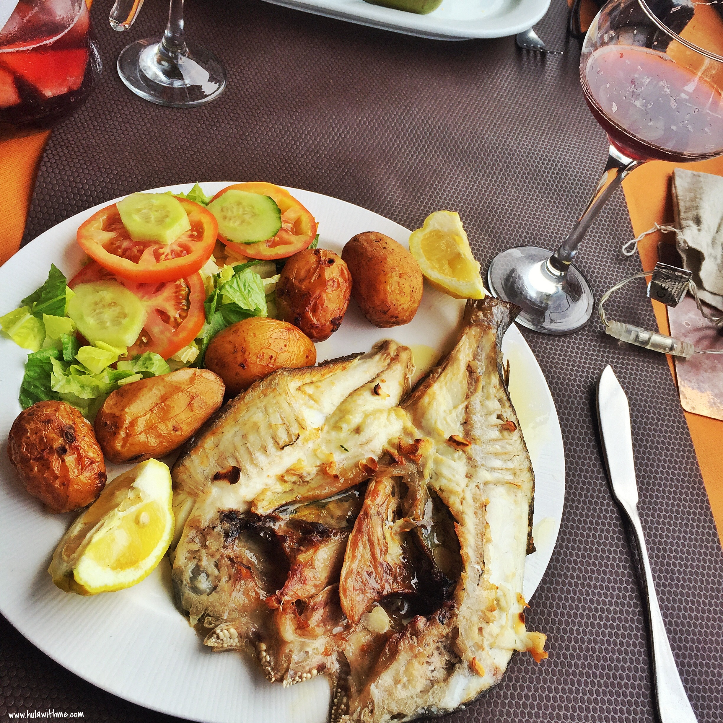Canary Islands Food Finds - O'Fado Portuguese Restaurant. Grilled fresh fish seasoned with olive oil; Canarian wrinkly potatoes side dish; a glass of sangria.