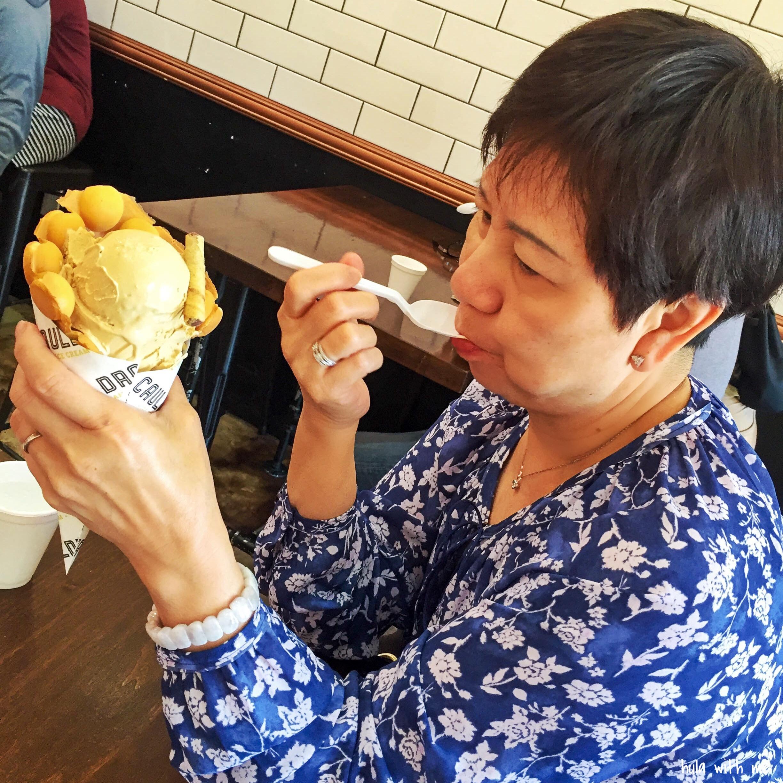 Enjoying Puffle Ice Cream prepared with liquid nitrogen at Cauldron Ice Cream in Orange County, CA