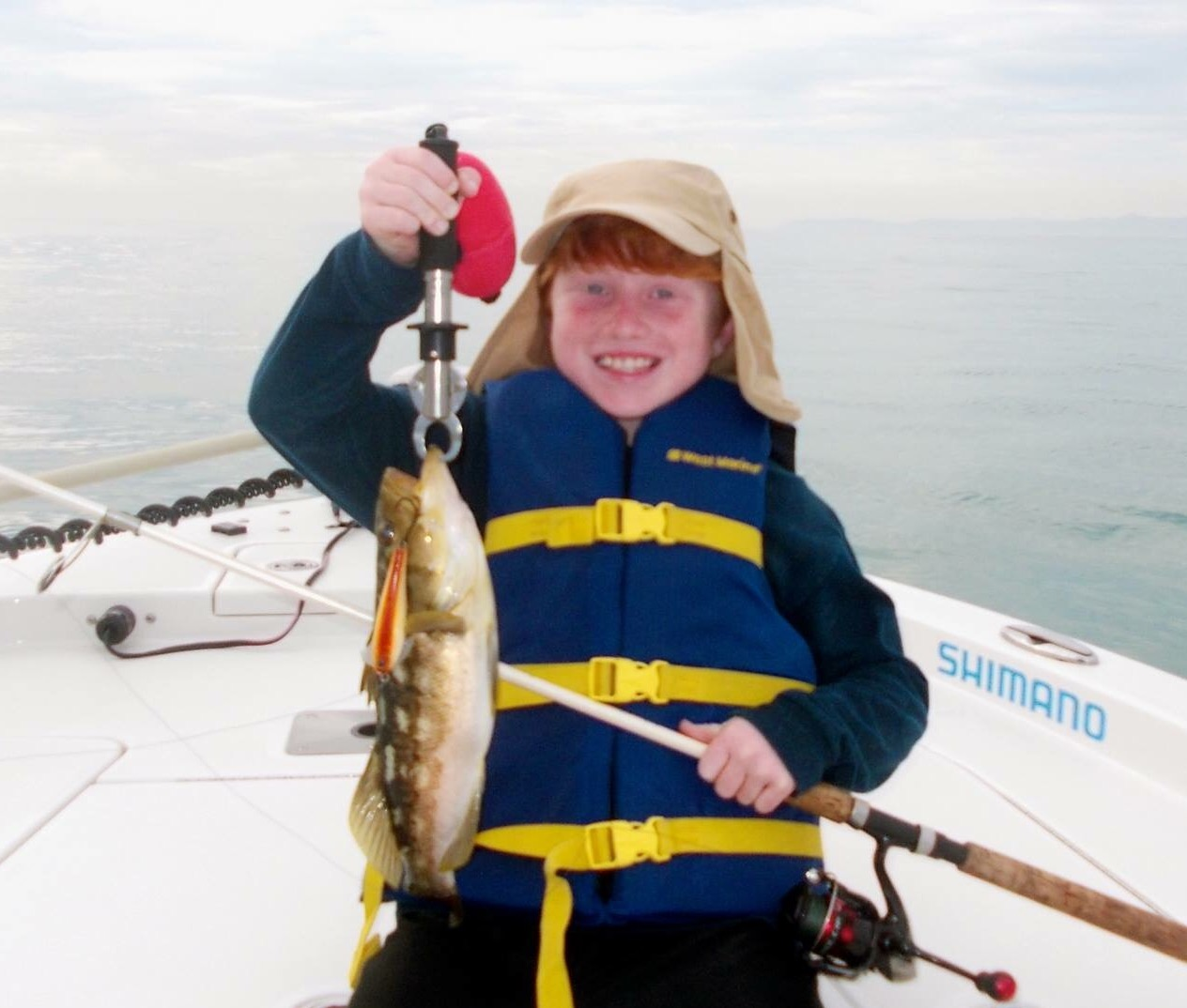 Hunter with a nice Calico Bass on the Wax Wing!