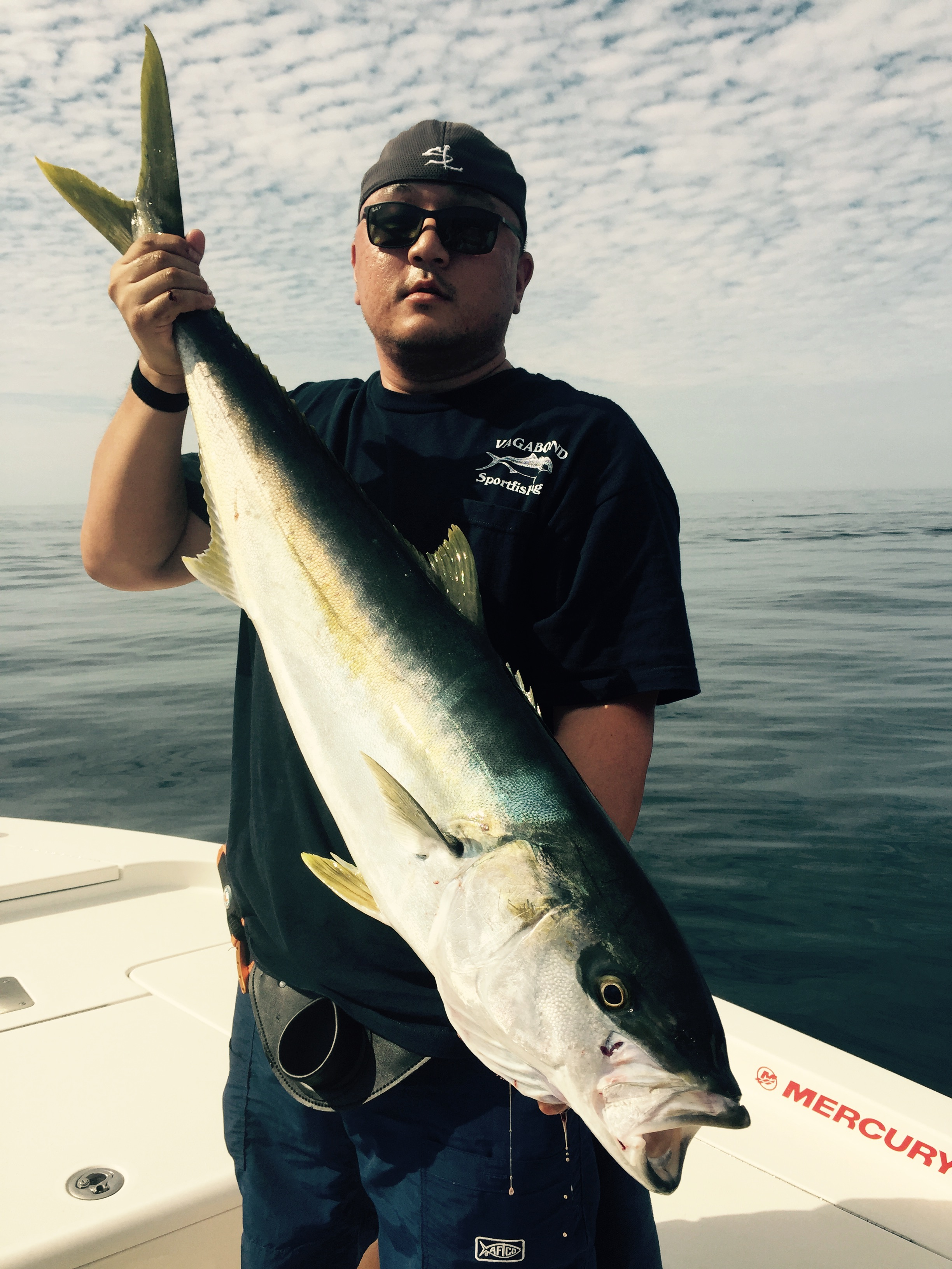 "Sam with a nice Yellowtail caught on a Kicker 25L in ""EnlightenMint"" color way!"