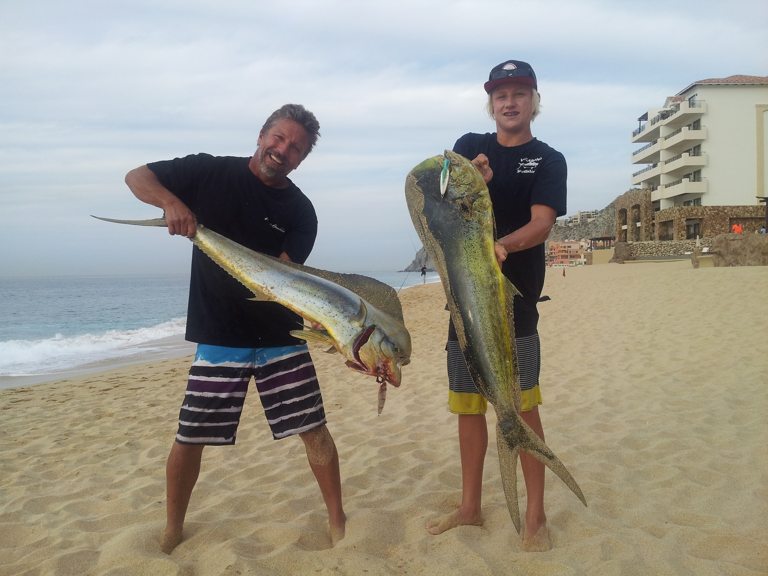 Mike on the Left and Luke on the right, with two nice Dorado outside their hotel, Solmar, in Cabo San Lucas BCS. Note the surface iron in Luke's fish.