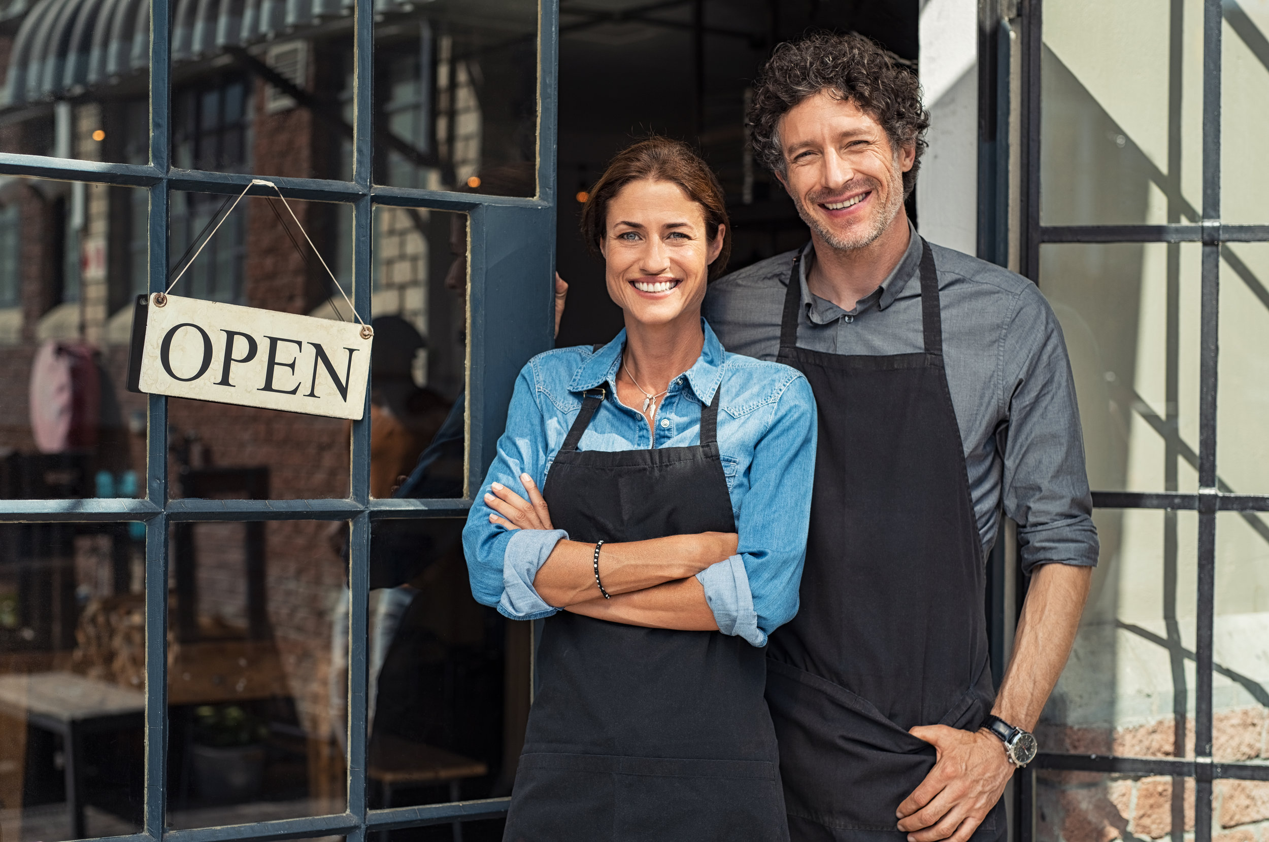 shutterstock_1277806525 - Small Business - happy couple opne sign.jpg