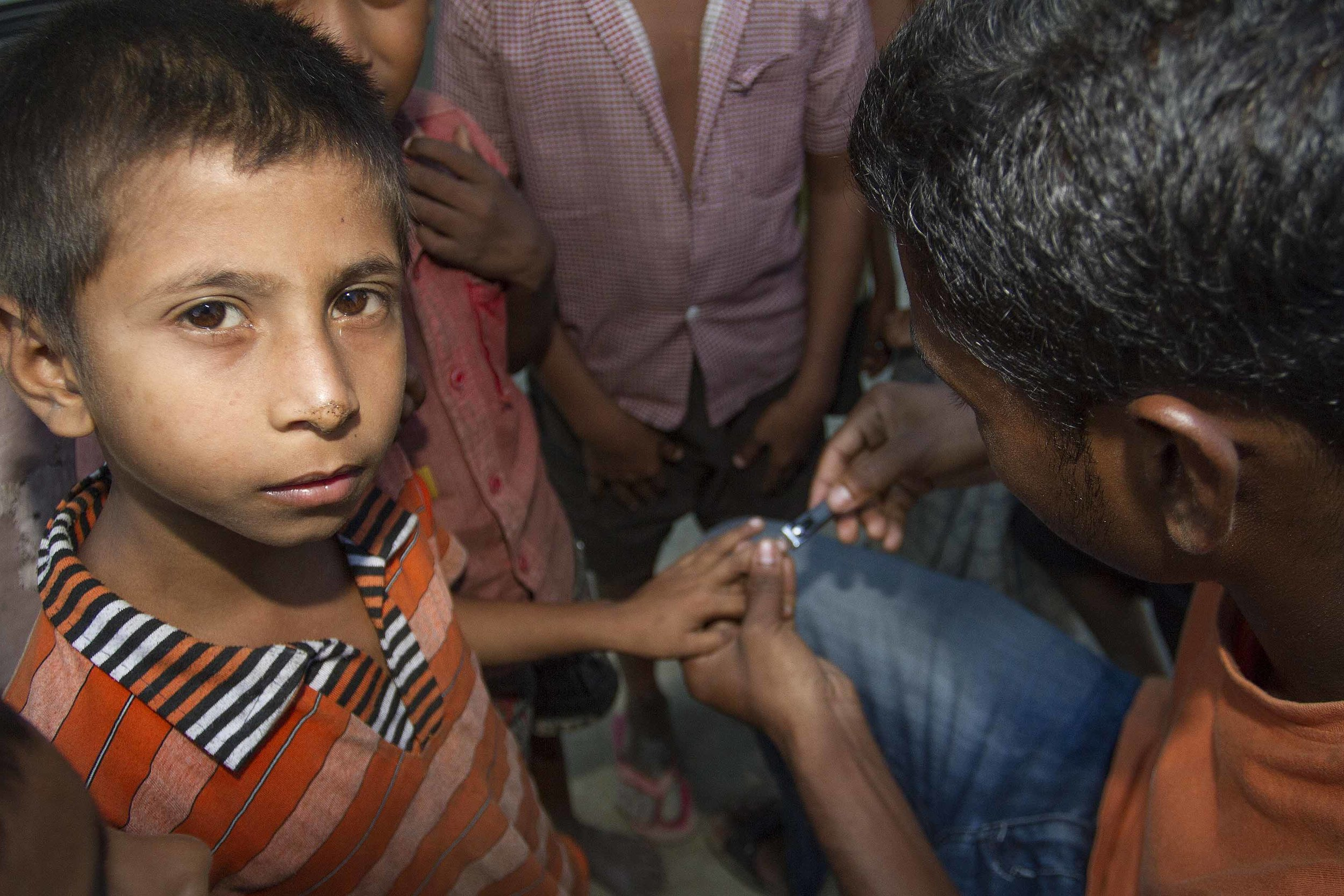 A young boy has his nails clipped by an Oxfam public health volunteer in a relief camp in Chirang district, Assam   - Assam Conflict Response Programme - Oxfam India