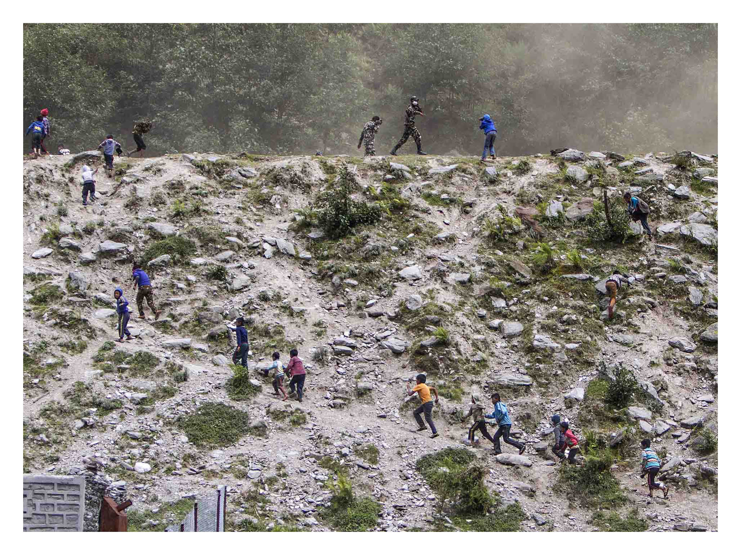Nepal Earthquake -  Children run to greet a UN helicopter delivering humanitarian aid, the first of many to reach the remote mountain village of Barpak, the known epicentre of the 7.8M earthquake.