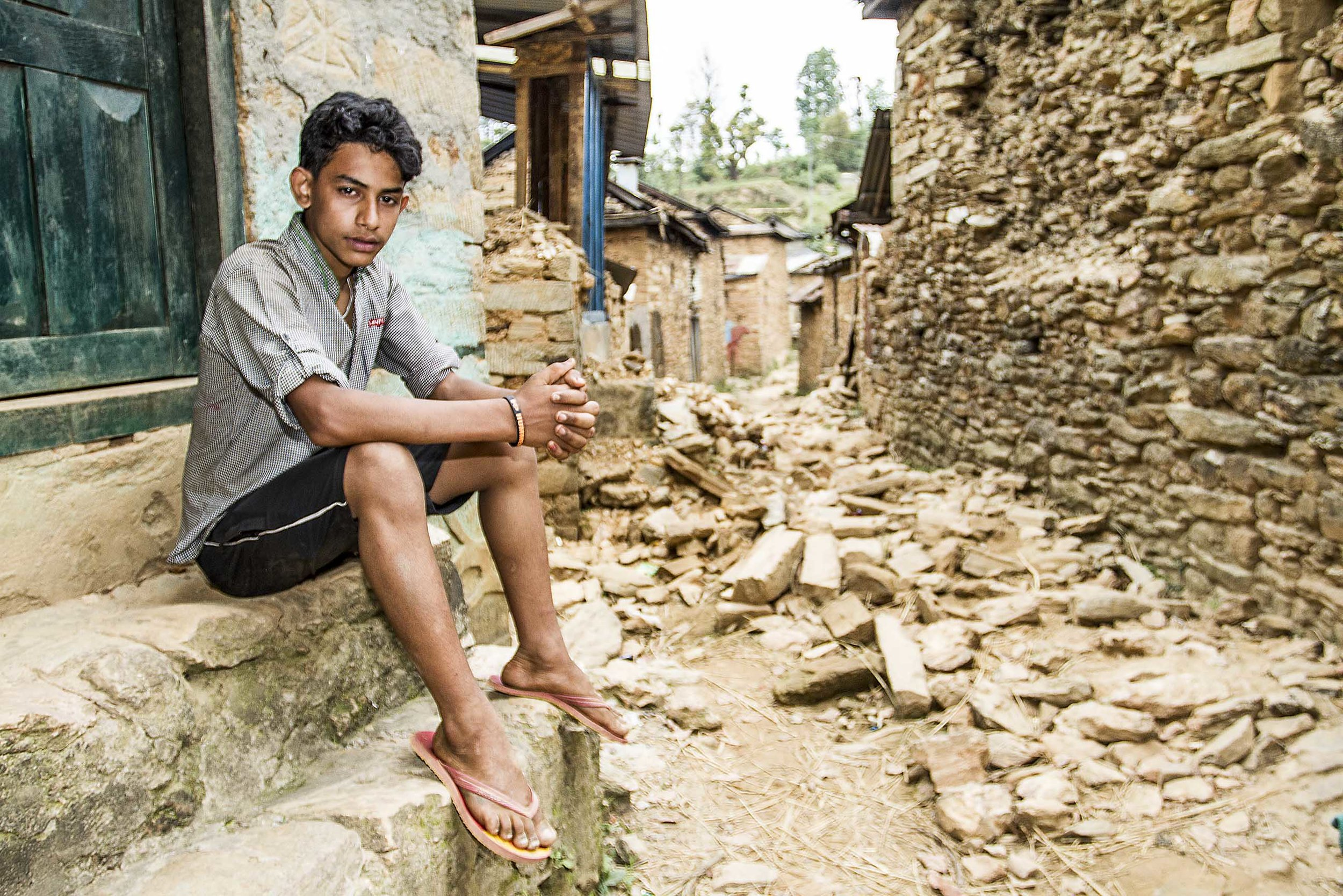 "Nepal Earthquake   Akhtar, like many young men from the area, migrated to India for better work opportunities, made all the more easier with the bilateral agreement where by the citizens of both countries do not require a visa. Working in a restaurant in Delhi for the past 3years, Akhtar earns a meagre salary but more than he would earn if he worked locally on the terraces or in the nearby town of Gorkha.  On the day of the earthquake Akhtar discovered what happened through social media.  ""I tried to call home immediately but the line was always busy""  After a desperate 2 days trying to reach his family he gets through, and to his relief discovers that no one was hurt.  ""I left for home as soon as I could, firstly it was a 12hr night bus to the border with Nepal, and then another 18hrs to get home, there was so much traffic leaving the country""  When he arrived home he could see that people were living on the roadside under tarpaulin sheets, and had little food.  ""Coming home was upsetting, especially seeing what was left of the family home""  ""The support that [you] have provided here has been really helpful, especially the additional tarpaulin""   Akhtar - Oxfam Beneficiary, Gorkha, Nepal"