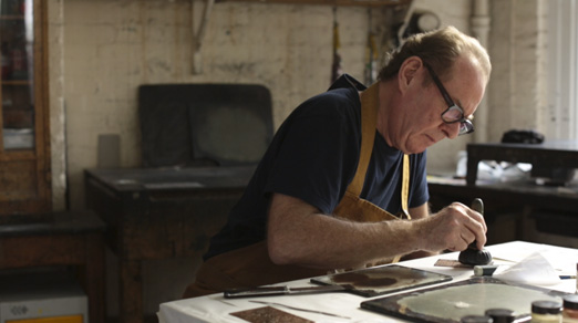 Michael Phillips Inking a relief-etched copper plate using a leather-covered dauber