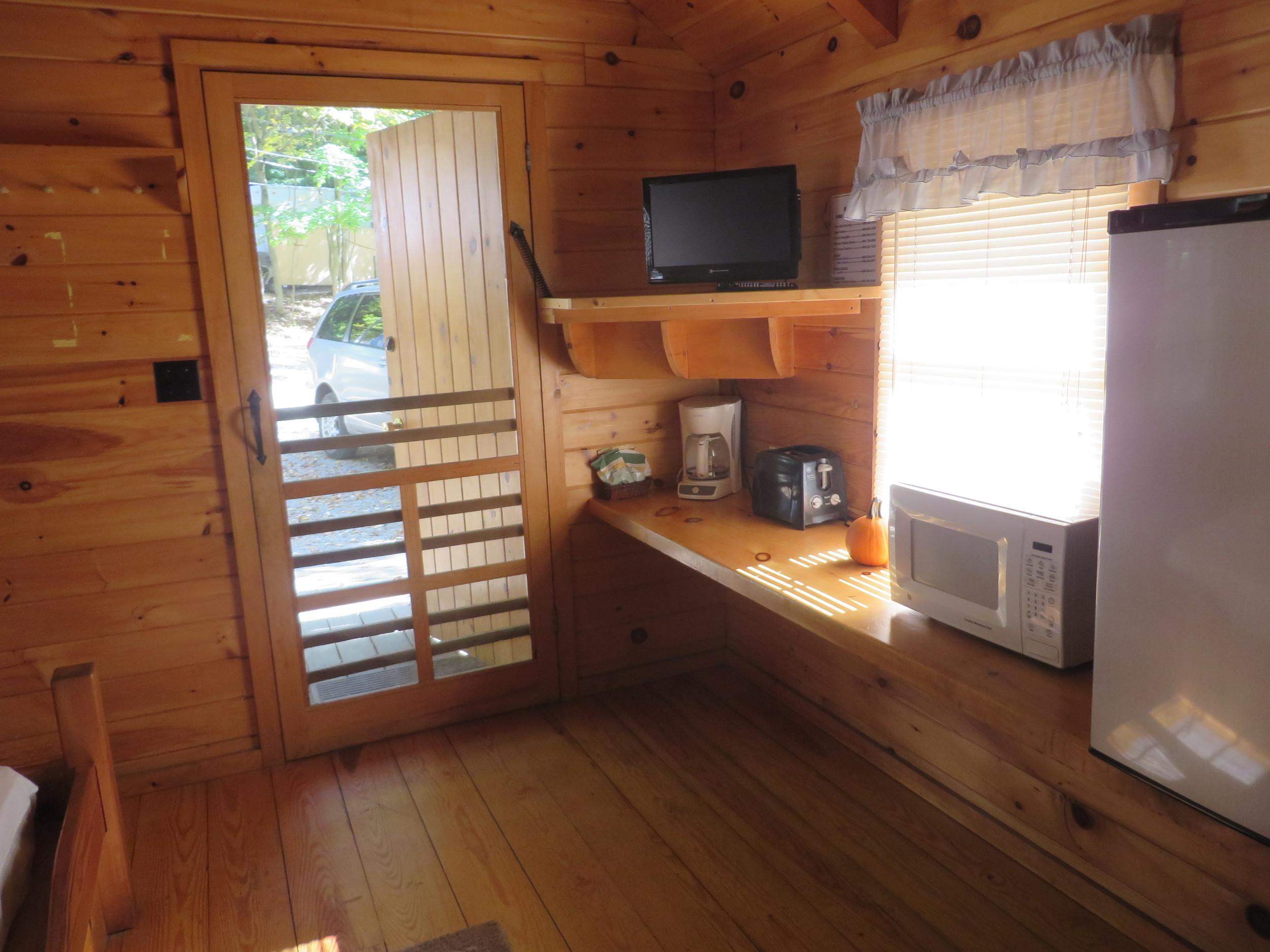 front door and kitchenette in cabin