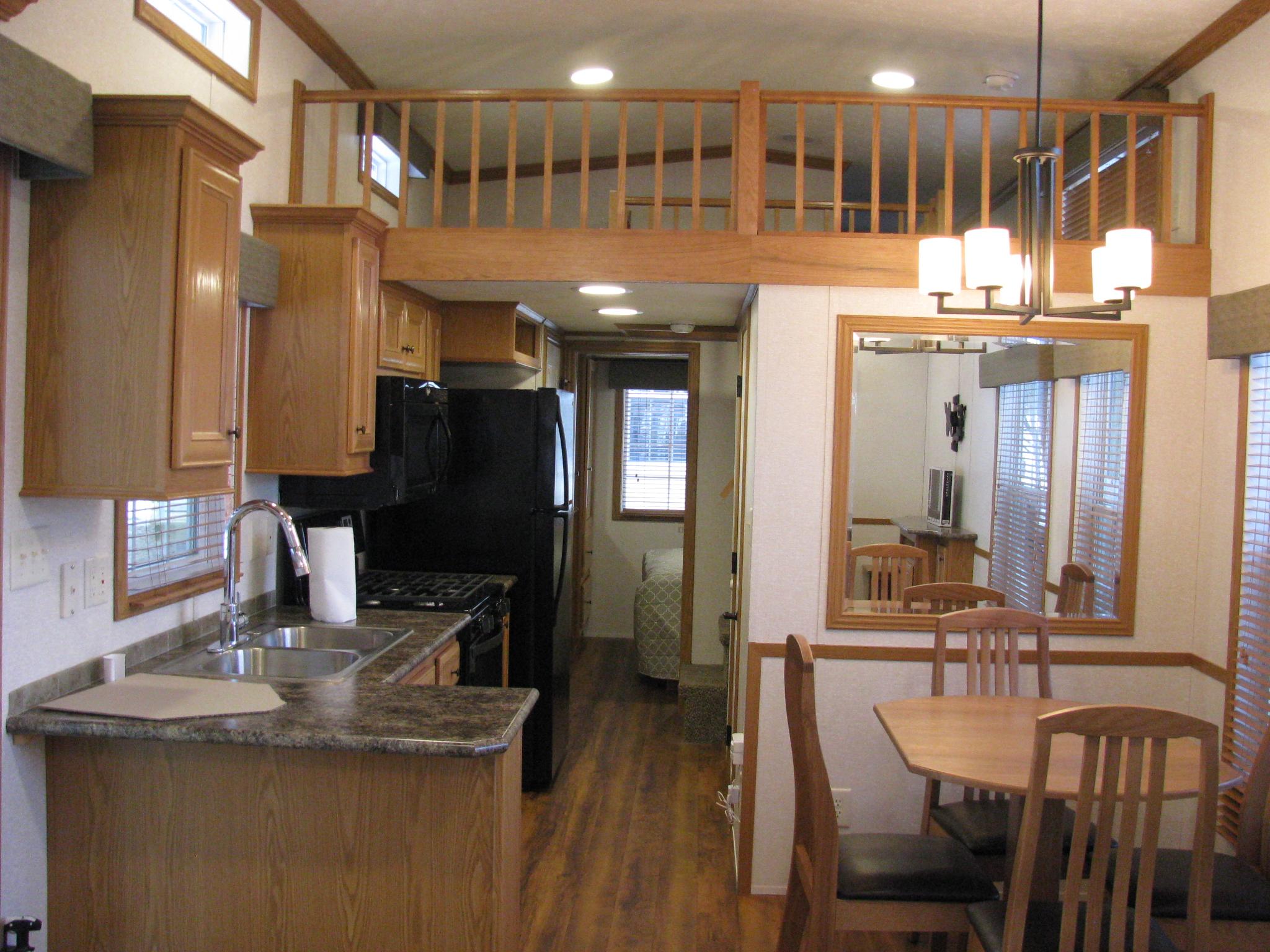 kitchenette, dining room, and loft of skyline trailer