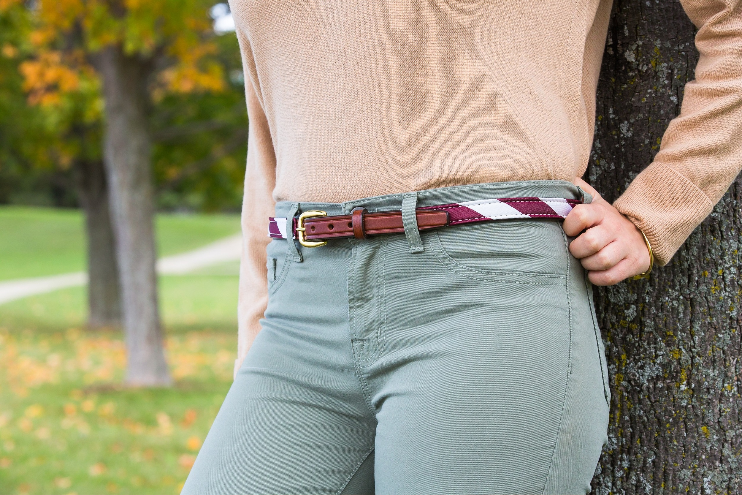 The Burgundy and White Repp Stripe Belt designed by Logan Richard.